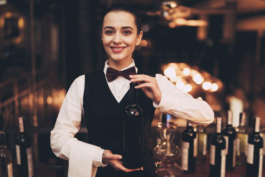 Sommelier tasting wine in restaurant.
